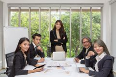 Team of asian business posing in meeting room. Working brainstor stock photo