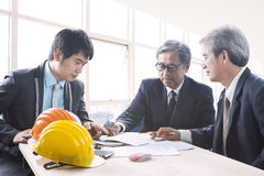 Team of asian engineering man project solution discussing in off Royalty Free Stock Photography