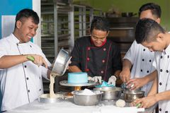 Team of asian male  pastry chef happy work together while preparing batter stock photos