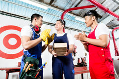 Team of Asian workers discussing product. As a work team Stock Photography