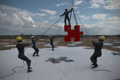 Team with jigsaw puzzle in field at noon as 3d rendering. A team assembling on a giant jigsaw puzzle project on a wheat field at noon Stock Photos