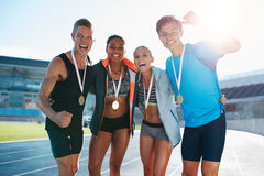 Team of athletes enjoying victory stock photo