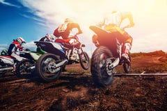 Team of athletes on mountain bikes starts royalty free stock images