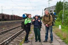 Team of backpackers waiting a train Stock Photo
