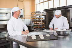 Team of bakers preparing dough Stock Photography