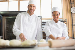 Team of bakers preparing dough Royalty Free Stock Images