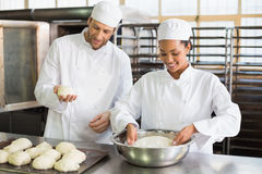 Team of bakers preparing dough Royalty Free Stock Photos