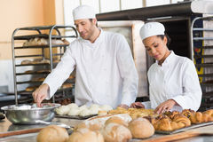 Team of bakers preparing dough and pastry Stock Image