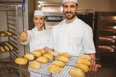 Team of bakers smiling at camera Royalty Free Stock Image