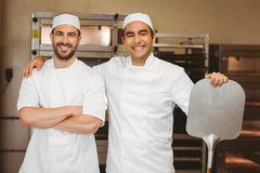 Team of bakers smiling at camera Stock Photos