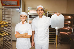 Team of bakers smiling at camera Royalty Free Stock Photography