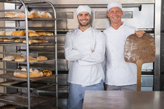 Team of bakers smiling at camera Royalty Free Stock Images