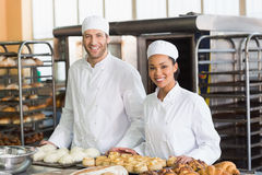 Team of bakers smiling at camera Royalty Free Stock Photos