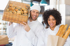 Team of bakers smiling at camera Stock Images