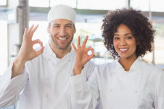 Team of bakers smiling at camera Stock Photo