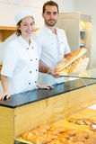 Team of bakers working at the bakery Stock Photography