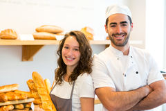 Team of bakers working at the bakery Stock Photo