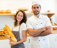 Team of bakers working at the bakery Royalty Free Stock Photography