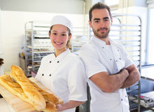 Team of bakers working at the bakery Stock Photos