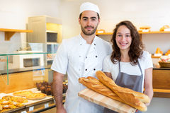 Team of bakers working at the bakery Royalty Free Stock Images
