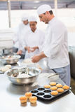 Team of bakers working at counter. In the kitchen of the bakery Royalty Free Stock Images