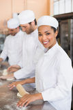 Team of bakers working at counter. In the kitchen of the bakery Stock Images