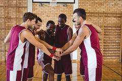 Team of basketball players stacking hands Royalty Free Stock Image