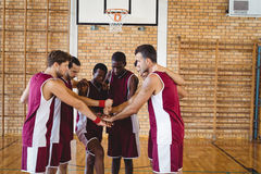 Team of basketball players stacking hands Royalty Free Stock Photos