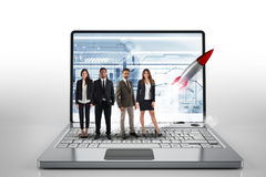 Team on a big laptop with a rocket ready to start. Concept of startup and innovation. 3D Rendering royalty free stock image
