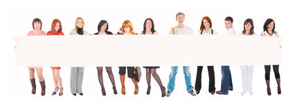 Team with a blank poster Royalty Free Stock Photography
