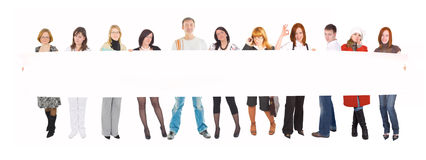 Team with a blank poster royalty free stock photos