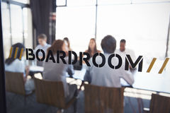 Team in a boardroom meeting, defocussed through glass wall Royalty Free Stock Photos