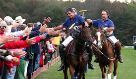 Team Brazil beats Team USA 11-6 in Polo. Members of Team Brazil shake hands with the spectators after beating Team USA 11-6 in polo stock photo