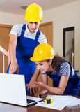 Team of builders brainstorming and smiling indoors Royalty Free Stock Photo