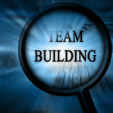 Team building. On a blue background with magnifier Royalty Free Stock Images