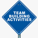 Team building activities. Text on a blue road sign, white background stock illustration