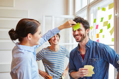 Team building game with sticky notes. Students in team building game with sticky notes Stock Image