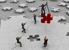Team building a great jigsaw puzzle Royalty Free Stock Image