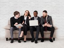 Team building, multiethnic team sitting on meeting royalty free stock photos