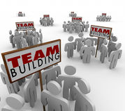 Team Building People Gathered Around Signs Meeting Teamwork Lear. Team Building people gathered meeting around signs in training or group sessions to learn Royalty Free Stock Photo
