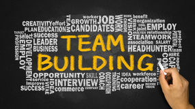 Team building with related word cloud hand drawing on blackboard stock photography