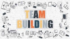 Team Building sur le mur de briques blanc Photos libres de droits