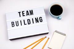 Team Building. Text in lightbox stock photos