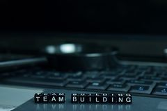 Team Building text wooden blocks in laptop background. Business and technology concept royalty free stock photo
