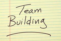 Team Building On un tampon jaune Photo libre de droits
