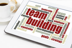 Team building word cloud. On a digital tablet with a cup of coffee Royalty Free Stock Photos