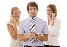 Team Business. One businessman and two businesswomen with mobile communications Stock Photography