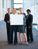 Team of business colleagues holding bill board Stock Images