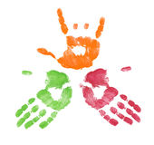 Team business deal. Multi colored finger painted hands with one making sign Stock Photography
