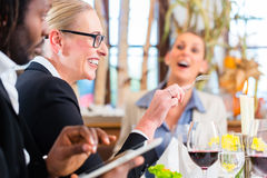 Team at business lunch meeting in restaurant Stock Photos